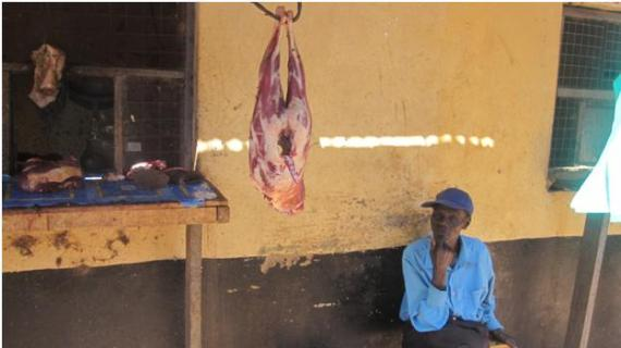 meat hanging in a market