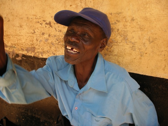 happy man in Uganda market