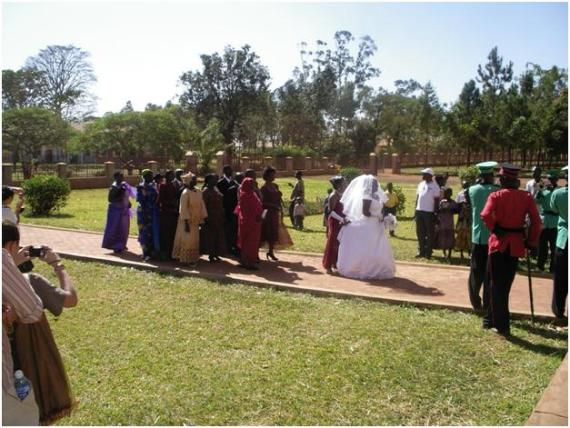 A beautiful bride leads the procession of an Acholi wedding